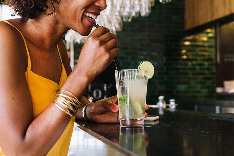 Woman-Drinking-Mojito